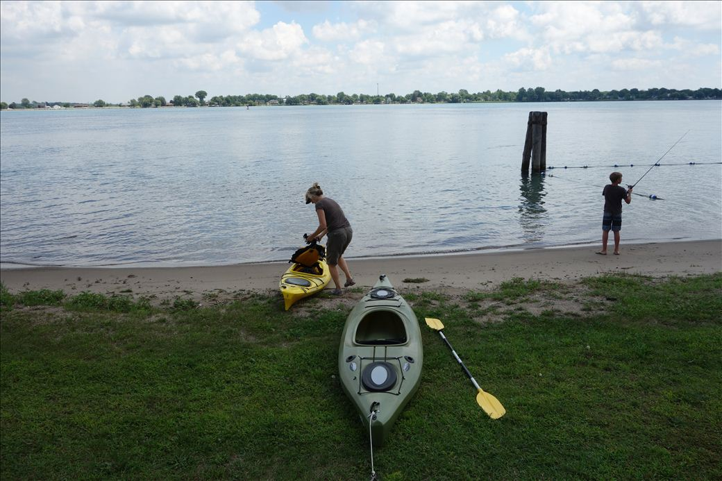 Person preparing a kayak for launch
